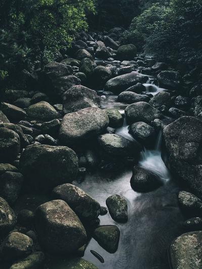 Stones in river stream
