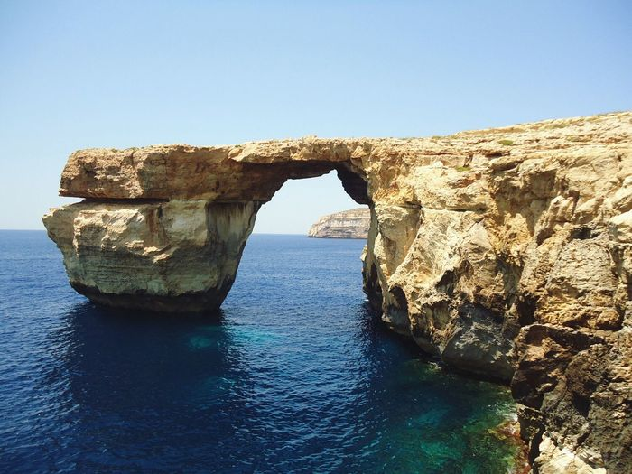 Malta 2015 Rock - Object Natural Arch Beauty In Nature Sea Geology Waterfront Clear Sky Physical Geography Nature Water Outdoors Day Nature Photography Your Ticket To Europe