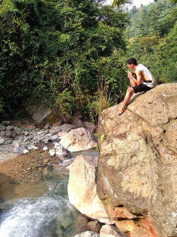 One Person Real People Day Water Outdoors Young Women Leisure Activity Young Adult Nature Women Lifestyles Shirtless Tree Beauty In Nature Adult People High Angle View Rock - Object Bonding Healthy Lifestyle EyeEmNewHere Indonesia_photography Indonesian Shooter Adult Beauty In Nature