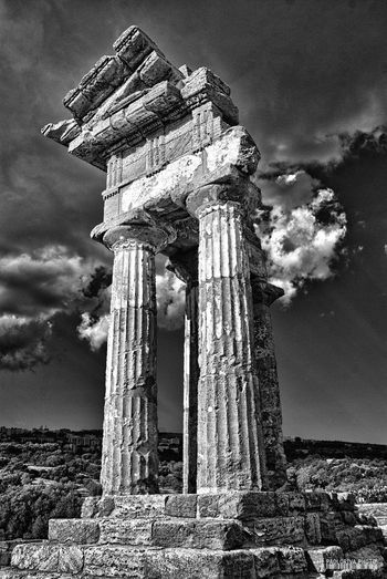 Agrigento Sicily Agrigento Temple Ancient Archaeology Architectural Column Architecture Built Structure Cloud - Sky Damaged Day Deterioration History Low Angle View No People Old Old Ruin Outdoors Ruined Sky Travel Destinations
