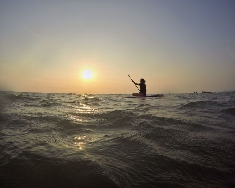 Sunset Horizon Over Water Beach Life Standing Stand Up Paddle SUP Working Out Sea Outdoors Clear SkyWaves, Ocean, Nature Wave Sky Sunlight Day Surf Sup Young Women Water Having Fun Summer Vacations