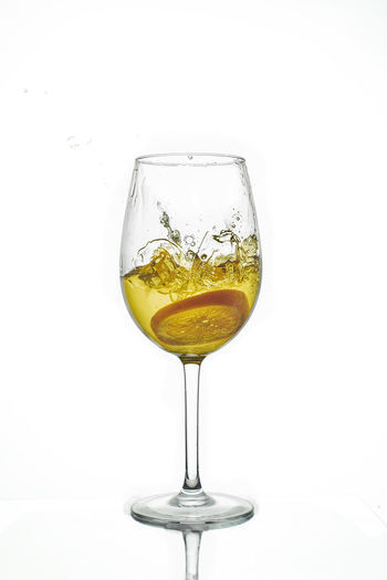 Glass of wine against white background