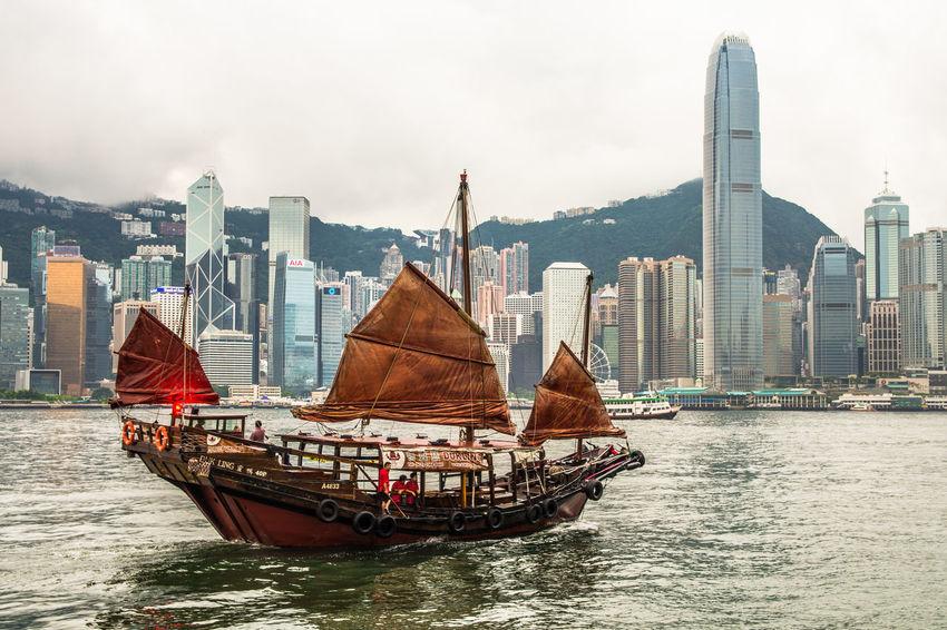 #Hong Kong #HongKongTrip #asia #boat #hongkong #travel #travelphotography Architecture City Cityscape Day No People Outdoors Sailing Skyscraper Travel Destinations Urban Skyline Water