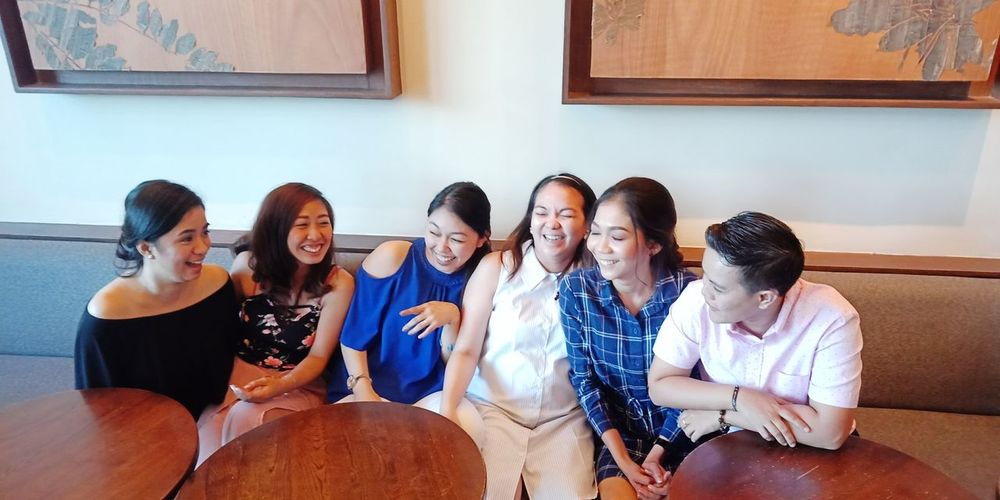 The not-so-scripted candid shot Bonding Happiness Candid Scripted Friends Friendship Teamwork Togetherness Young Women Sitting Business Innovation Women Businesswoman Colleague
