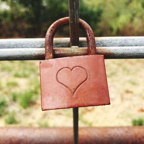 Heart Shape Metal Padlock Close-up Love Railing Lock Safety Focus On Foreground Day No People Positive Emotion Protection Emotion Security Hanging Outdoors Love Lock Rusty Fence