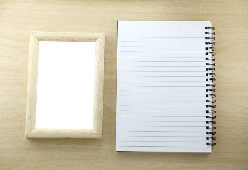 Note paper book and wood picture frame in empty on wooden background,You can enter your text and images. Wood Blank Book Copy Space Directly Above Education Empty High Angle View Indoors  No People Note Pad Note Paper Open Page Paper Publication Spiral Notebook Still Life Table Two Objects White Color Wood - Material Wooden Wooden Texture Woods