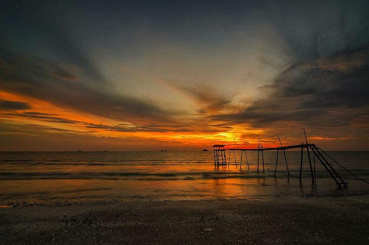 Majestic sunset at sandy beach Sunset Sunrise Nature Photography Nature Burning Sky Burning Sky Cloud - Sky Shadows & Lights Seascape Beach Twilight Dusk Silhouette Sunrise Dawn Wooden Structure Piping Sandy Beach Shell Sun Sun Over Horizon Malaysia Bali Hawaii Horizon Pantai Shadow Fishing Fishermen