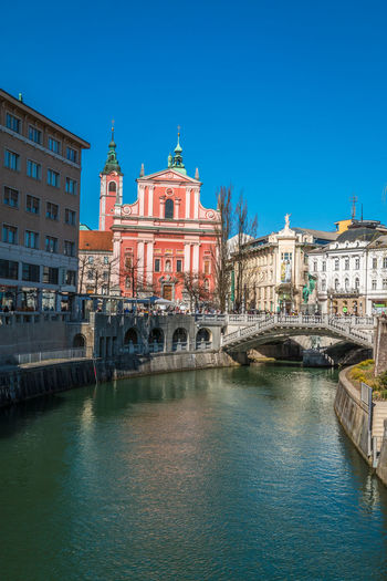 Assumption church in Ljubljana Slovenia Church Ljubljana Architecture Assumption Assumption Church Blue Building Exterior Built Structure Canal City Clear Sky Day Gondola - Traditional Boat Nautical Vessel No People Outdoors Place Of Worship Religion Sky Spirituality Travel Destinations Water Waterfront