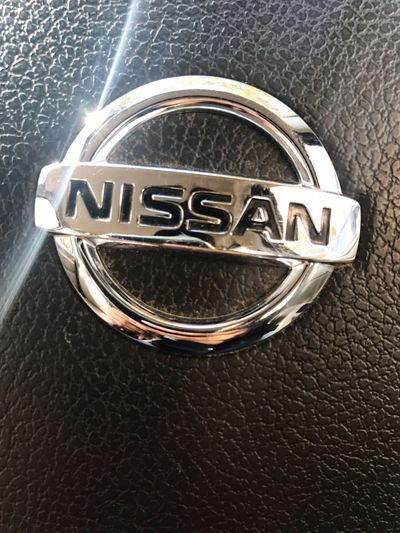 Nissan Stearing At The Camera Light Out The Symbol Light And Shadow Click On IPhone 7