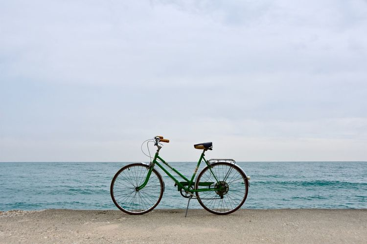 Bicycle On Coast Against Sky