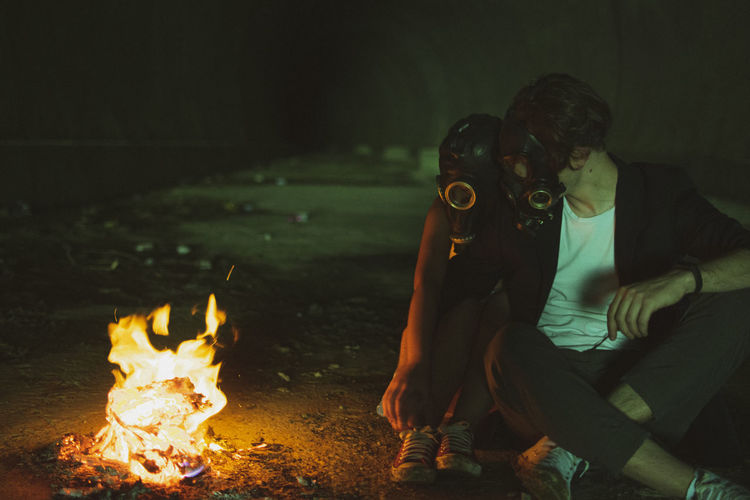 People sitting on fire at night