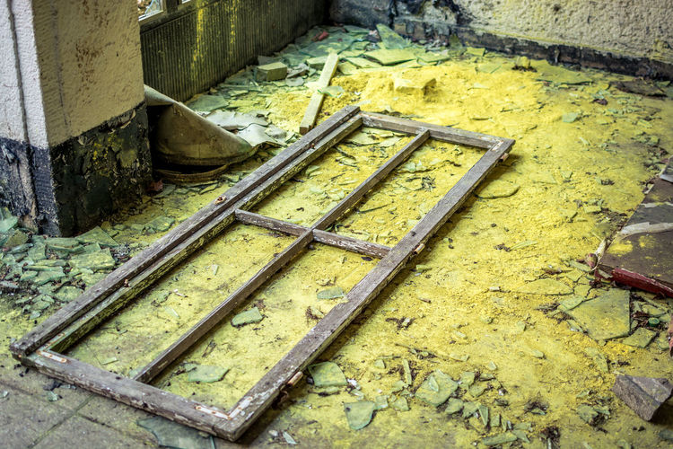 No People Architecture Built Structure Metal High Angle View Day Yellow Old Industry Outdoors Close-up Wood - Material Dirt Nature Concrete Bad Condition Rusty Wall - Building Feature