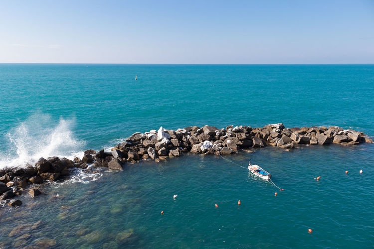 Rocks And Water Rocks Itlay Riomaggiore Cinque Terre Boat Solo Traveler! Tranquility Scenics Nature Ocean Sunny Day No People Sea Waves