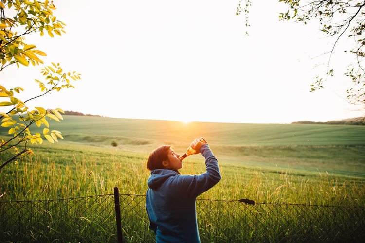 cheers! Alcoholic Beverages Beer Agriculture Alcohol Alcoholic Drink Beauty In Nature Beer Time Clear Sky Day Field Landscape Lifestyles Nature One Person Outdoors Plant Real People Rural Scene Scenics Sky Standing Sunset Tranquil Scene Tree Women