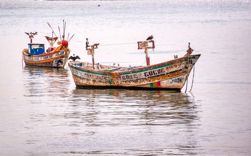 Fishing boat moored in sea