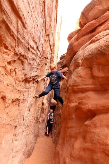 spider climb on sandstone, a little different than our walls at home. Childhood Children Only Adventure Buddies Summer Exploratorium Extreme Sports Climbing Sports Team Rock Face Desert Sport Rock Climbing Mountain Adventure Cliff Sandstone