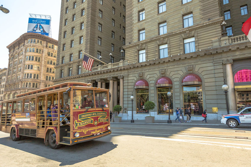 San Francisco, CA, United States - August 17, 2016: crowds of tourists in the popular Union Square, the central square of San Francisco on Market Street, known as the place shopping and luxury hotels. San Francisco, California, United States - August 17, 2016: the Big Bus, Hop On Hop Off, Sightseeing Tour, the popular double-decker bus carrying tourists, standing in Union Square, during a day tour. Cable Car California Market SF San Francisco Square Union Union Square SF United States Architecture Building Exterior Built Structure City Day Land Vehicle Market Street San Francisco Market Street Mode Of Transport No People Outdoors Street Transportation Union Square  Unionsquare