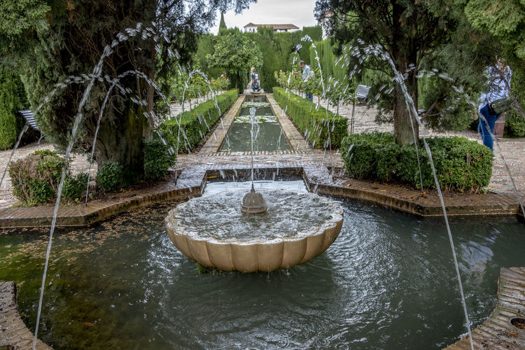 GRANADA, SPAIN - October 11, 2018: The famous Alhambra in Granada, Spain. It is a palace and fortress complex located in Granada. Granada SPAIN Alhambra Alhambra De Granada  Architecture Arabic Style Ancient Architecture Mosque Architecture Interior Design Water Tree Plant Fountain Nature Motion Incidental People Day Flowing Water Waterfront Spraying Park Built Structure Lake Splashing Outdoors Park - Man Made Space Growth Flowing