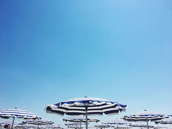Copy Space Clear Sky Blue No People Outdoors Day Beach Umbrella Sunshade Summer Striped White Blue Sky The Week On EyeEm Fresh On Market 2017