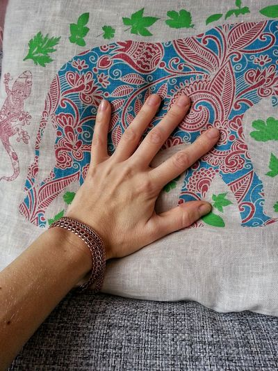 Cropped Hand Of Person Touching Textile