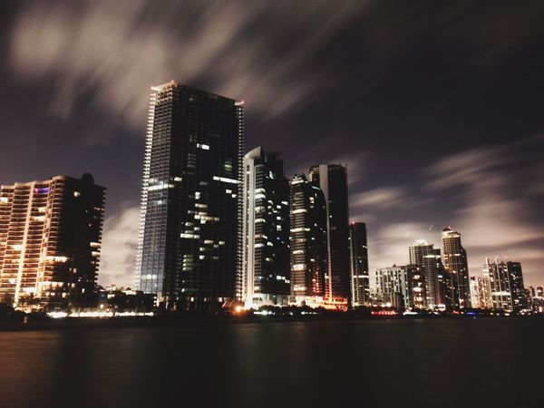 Miami night lights long exposure Building Exterior Built Structure City Illuminated Architecture Building Office Building Exterior Skyscraper Sky Modern Night Water Cityscape Urban Skyline Tall - High Waterfront Residential District Landscape Nature No People