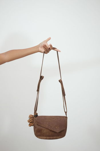 Leather Leather Bag White Background Hanging Studio Shot Business Finance And Industry The Still Life Photographer - 2018 EyeEm Awards