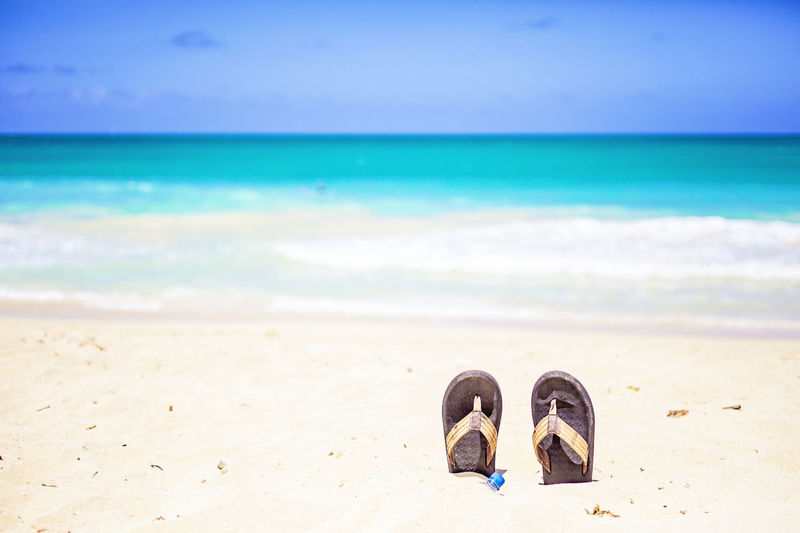 Flip-Flops In Sand At Beach