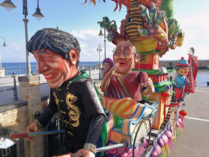 Maiori, Campania, Italy - March 4, 2019: Allegorical floats in the square of the port for the 46th edition of the Grand Carnival of Maiori Italy Campania Salerno Italy Grand Carnival Of Maiori Amalfi Coast Colorful Floats Carnival - Celebration Event Allegorical Floats Maiori, Day Real People Lifestyles Leisure Activity People City Representation Traditional Clothing Incidental People Multi Colored Sky Art And Craft Celebration Outdoors Festival