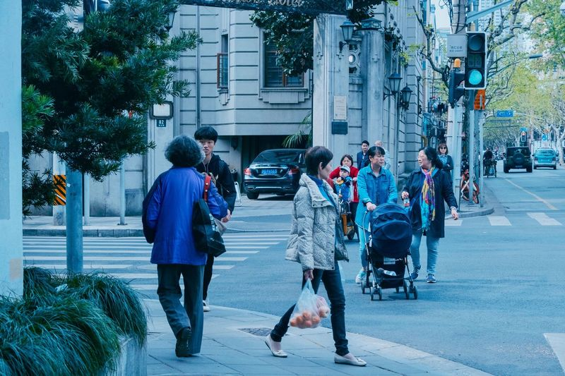 Shanghai, China China City Building Exterior Men Street Architecture Real People Lifestyles Transportation Built Structure Group Of People Adult Car Tree Mode Of Transportation Land Vehicle Full Length Walking Motor Vehicle People Day
