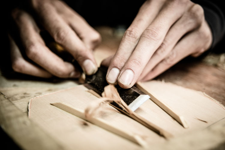 instrument maker in San Telmo, Buenos Aires Handicraft Hands At Work Instrument Instrument Maker String Instrument Tool Trade Traditional Wood Wood Chippings Your Design Story Winners 🎁
