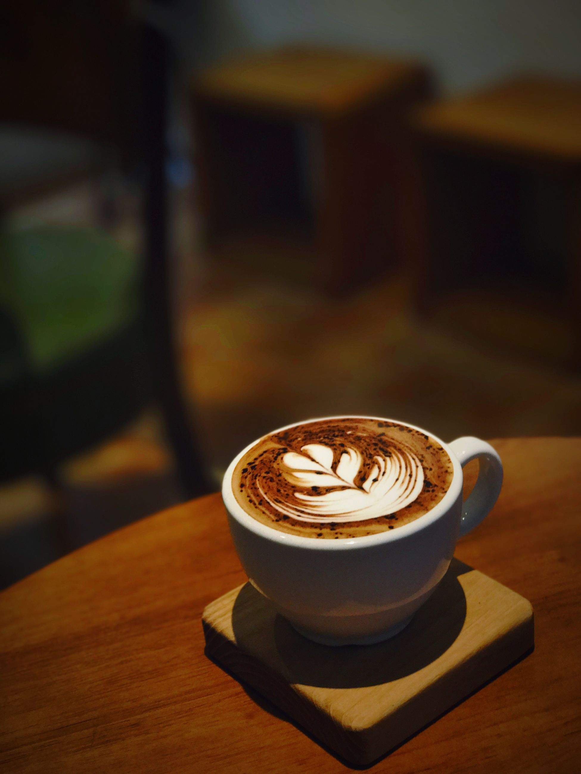 coffee - drink, coffee cup, cappuccino, drink, focus on foreground, table, cup, froth art, close-up, frothy drink, espresso, latte, mocha, indoors, no people, day