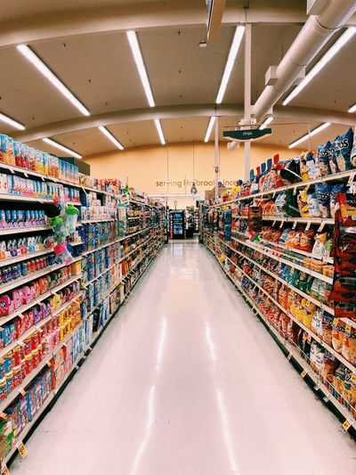 Food And Drink Market Shopping USA Absence Abundance Aisle Arrangement Ceiling Choice Consumerism Diminishing Perspective Food Food And Drink Groceries Hall Indoors  Large Group Of Objects Multi Colored No People Order Retail  Shelf Shop Shopping Shopping Mall Store Supermarket Variation