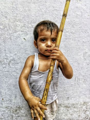 Portrait of a little angry young child holding Lathi Revange Eyes Asian  Face Young Boy Furious Kid Indian Culture  Looking At Camera Funny Confidence  Pride Ready To Fight Fighter Frowning Displaced Frustration Sulking Distraught  Indian Child Childhood Facial Expression Portrait Thoughtful Grimacing Tantrum Posing The Portraitist - 2018 EyeEm Awards A New Perspective On Life