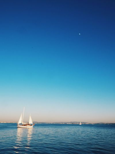 Beauty In Nature Blue Clear Sky Day Horizon Over Water Mast Mode Of Transport Moon Nature Nautical Vessel No People Outdoors Sailboat Sailing Sailing Ship Scenics Sea Sky Tranquil Scene Tranquility Transportation Water Waterfront Yacht Yachting