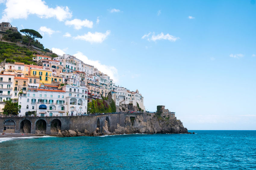 Architecture Beauty In Nature Building Exterior City Cityscape Cloud - Sky Coastline Colorful Copy Space Day Horizon Over Water Lifestyles Mediterranean Culture Mediterranean Sea Mountain Nature No People Outdoors Sea Sky Tourism Travel Travel Destinations Vacations Water