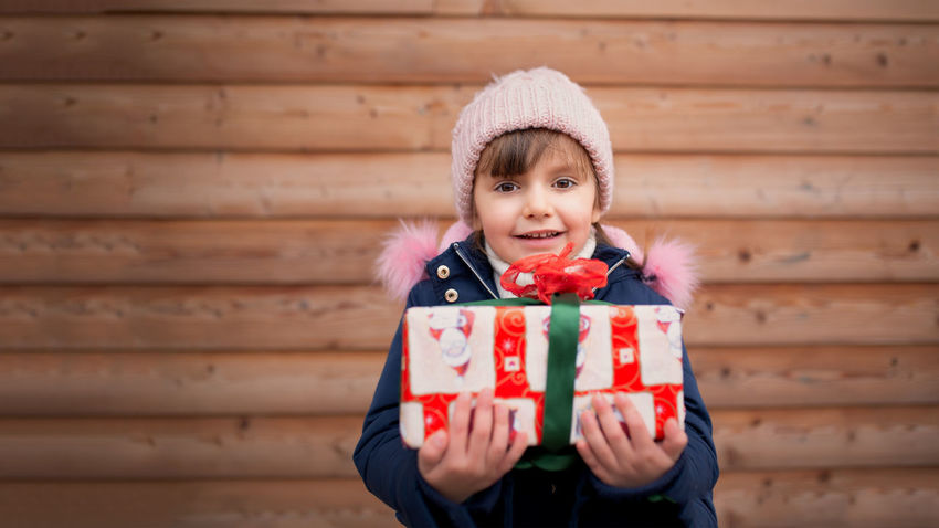 Merry Christmas Christmas Gift Merry Christmas! Girl Colors Happy Happy People Santa Claus Canon Beauty Happiness Smiling Front View Childhood Portrait Celebration Child Holding Emotion Looking At Camera Warm Clothing Cute Innocence Hat Clothing Holiday
