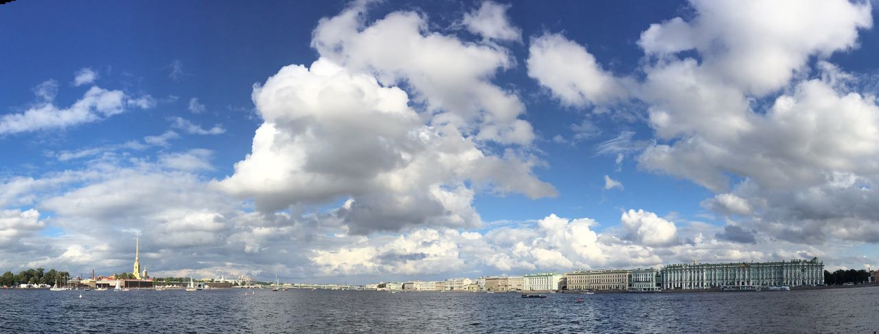 City by neva river against sky