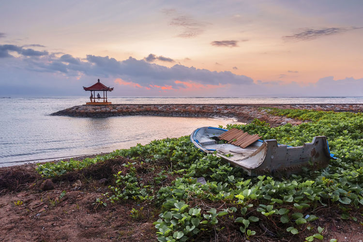 Beautiful Scenery at Karang Beach, Sanur, Bali, Indonesia Bali Holiday INDONESIA Pagoda Relaxing Architecture Beach Beauty In Nature Built Structure Cloud - Sky Horizon Horizon Over Water Idyllic Land Nature No People Outdoors Plant Scenics - Nature Sea Sky Sunset Tranquil Scene Tranquility Water