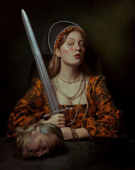 Portrait of medieval woman holding a sword