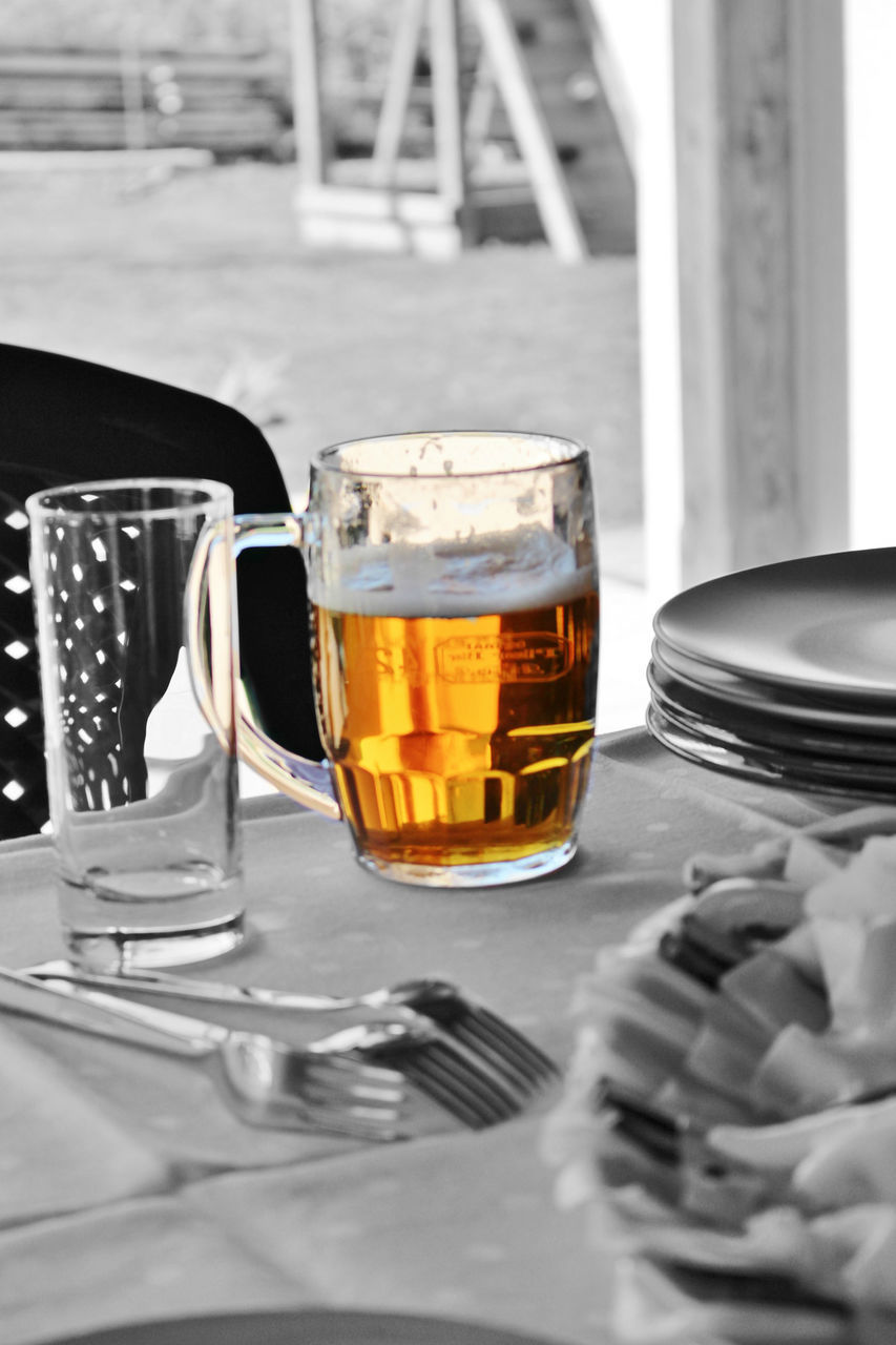 food and drink, drink, table, refreshment, still life, kitchen utensil, food, eating utensil, glass, indoors, household equipment, freshness, no people, fork, drinking glass, selective focus, beer, close-up, frothy drink, beer - alcohol