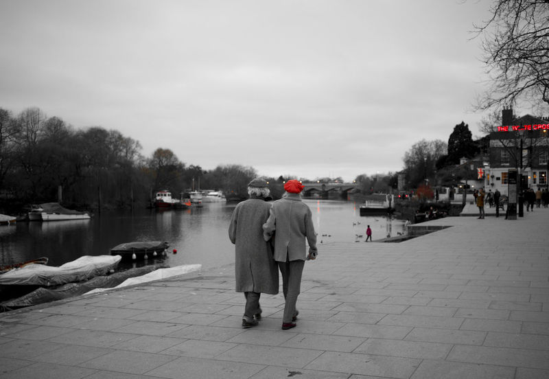 Adults Only Black & White Couple - Relationship Grey Older Couple Outdoors Real People Red Relaxing Richmond Upon Thames Riverbank Riverside Sidewalk Sky Walking White Cross Wintertime