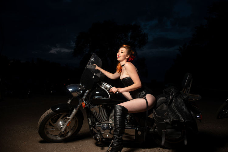 Portrait of woman riding motorcycle
