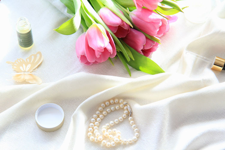 Plant Flowering Plant Freshness Pink Color Nature Flower Vulnerability  Fragility Flower Head Still Life Indoors  Inflorescence Close-up Tulip White Color No People High Angle View Beauty Cosmetics Pearls Butterfly Concept Spring Inspiration Beautiful