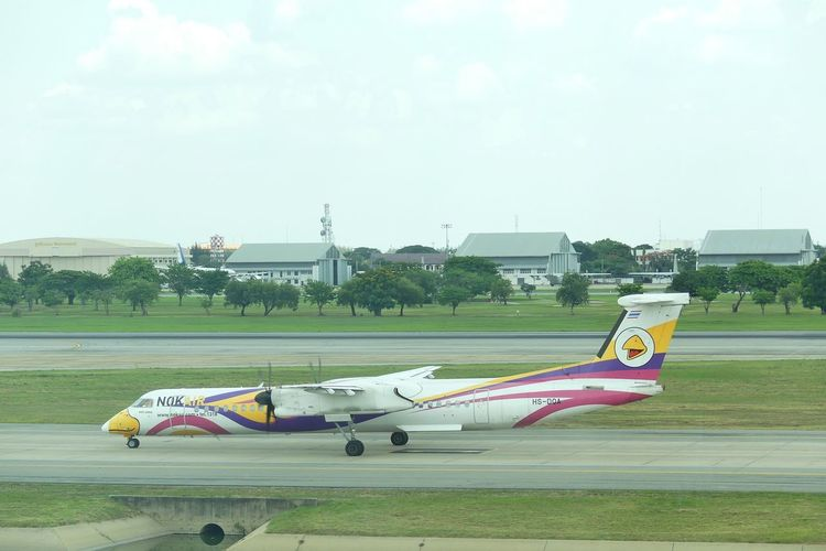 Bangkok, Thailand - April 14,2017 : New baby NOK ANNA, Thailand's First Q400 NextGen. Taxiing on runway at Don Mueang International Airport on April 14, 2017. NOK Air is a Thai low-cost Airline. Airline Airlines Airplane Airport Architecture ATR Airplane Bangkok Airport Bangkok Thailand. Day Don Mueang International Airport Fight Flying International Airport Low-cost Airline No People Nok Air Outdoors Plane Q400 Sky Taxiing Transportation Tree นกแอร์ สนามบินดอนเมือง