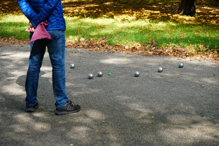 boules game Boccia Boule Boules Balls Game Leisure Activity Low Section Outdoors Park People Petanque Playing Real People Sport Unrecognizable Person