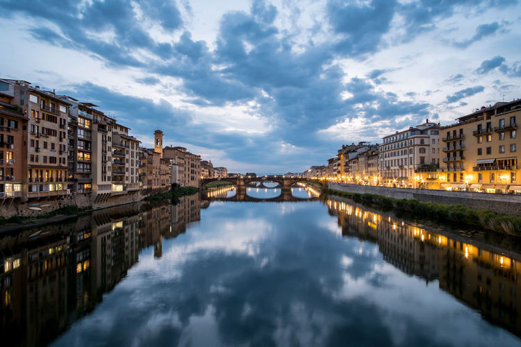 View of the Bridge and Building along Arno river in Florence, Italy. At night. Arno River Architecture Bridge Building Exterior Built Structure City Cloud - Sky Day Florence Italy Nature No People Outdoors Reflection Residential Building Sky Travel Destinations Water Waterfront
