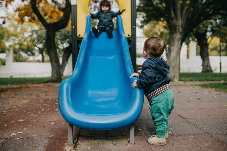 Bother and sister playing in playground