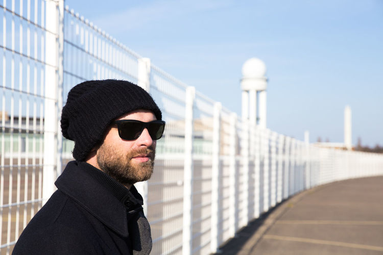 sunny afternoon at Tempelhofer Feld with the new cam :) // Airport Casual Clothing City Front View Headshot Hipster Leisure Activity Lifestyles Modern Portrait Portrait Of A Friend Sunglasses Tempelhof Airport Young Adult Young Men Urban Spring Fever Beard Fence