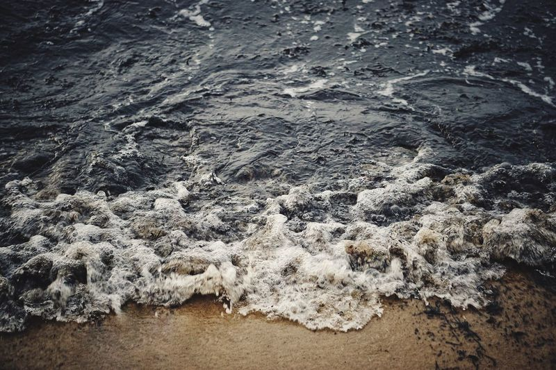 High angle view of waves reaching shore at beach