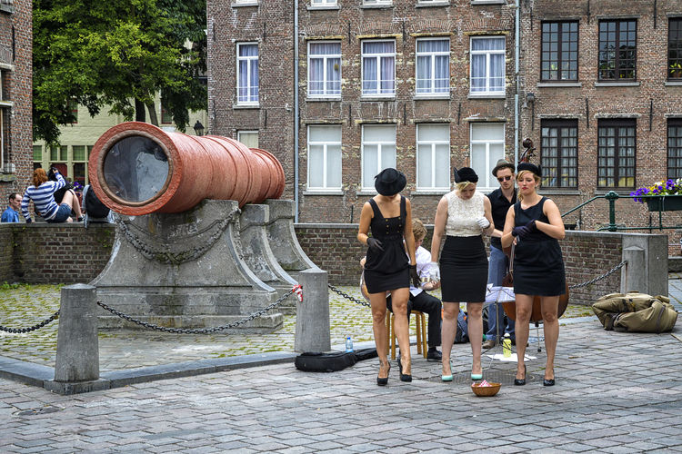 Women dancing in the streets Architecture Building Exterior Built Structure Busker Casual Clothing City City Life City Street Dance Day Full Length Girls History In Front Of Men Musical Outdoors Performance Performing Person Standing Street Streetart Togetherness Women
